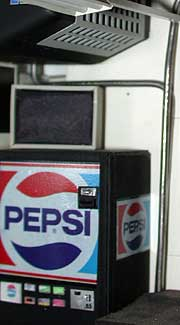 Scratchbuilt Pepsi soda machine, tv set, and custom heater blower